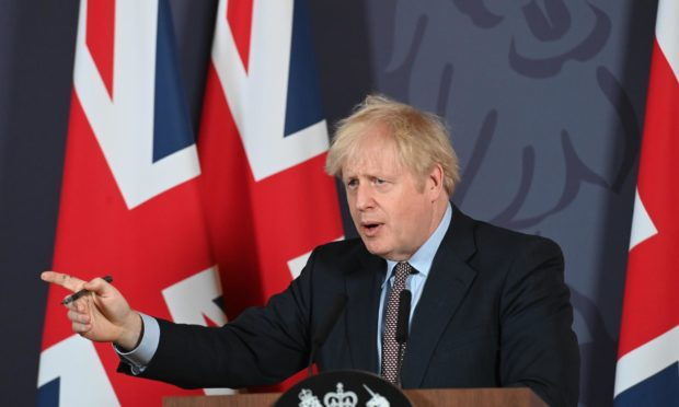 Britain's Prime Minister Boris Johnson speaks during a media briefing in Downing Street.