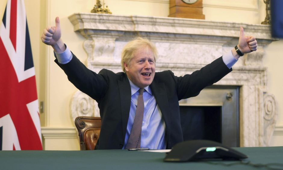 Prime Minister Boris Johnson reacts from 10 Downing Street as Britain and the European Union reach a deal.