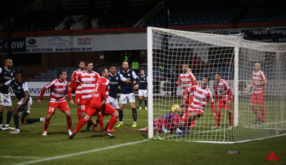 Dundee's Jonathan Afolabi (second from left) sees his late effort find the net to deny Bonnyrigg.