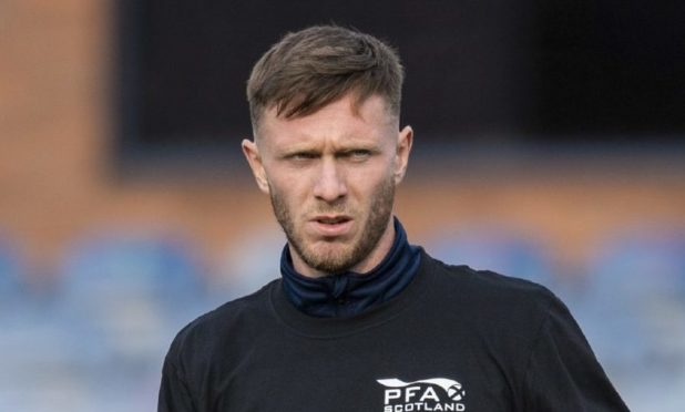 DUNDEE, SCOTLAND - OCTOBER 24: Dundee's Jordan McGhee warms up with Show Racism the Red Card t shirt during a Scottish Championship match between Dundee and Greenock Morton at Dens Park, on October 24, 2020, in Dundee, Scotland (Photo by Ross Parker / SNS Group)
