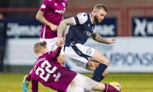 Dundee star Christie Elliott keen to keep feel-good factor flowing and says he's loving his time at Dens after earning new deal