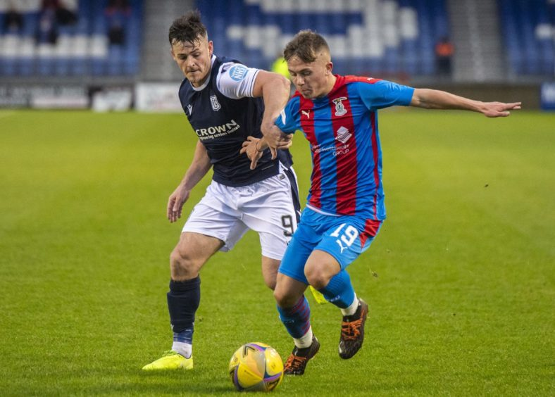 Kai Kennedy in action for Inverness up against Dundee ace Danny Mullen.