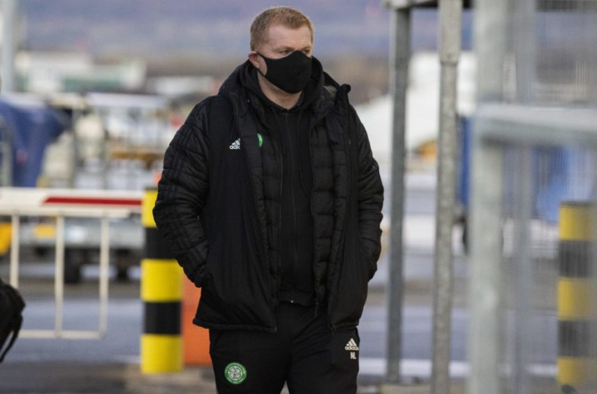 Celtic boss Neil Lennon pictured at Glasgow Airport ahead of Dubai trip.