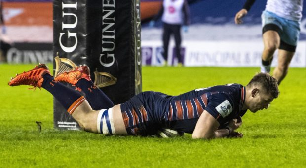 Magnus Bradbury gets downward pressure - just - to score Edinburgh's crucial try.