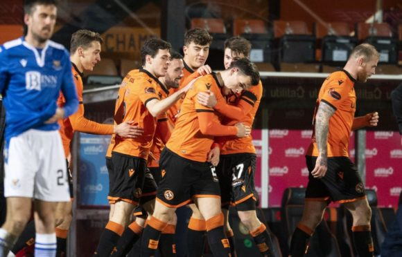 Lawrence Shankland is mobbed by teammates after his amazing equaliser.