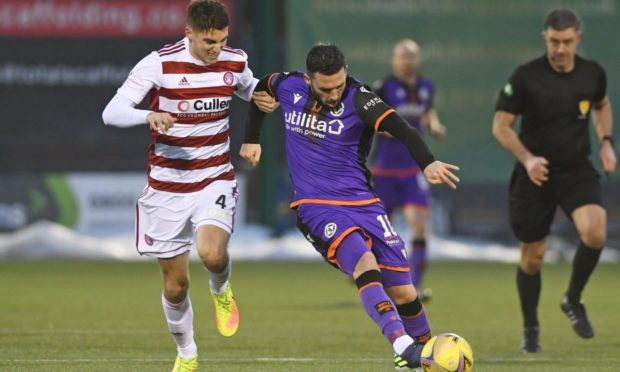 Nicky Clark shields the ball from Hamilton's Ben Stirling.