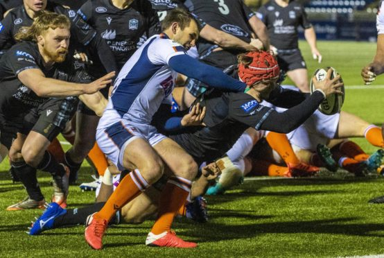 Geoiirge Taylor dives in for Glasgow's second try.