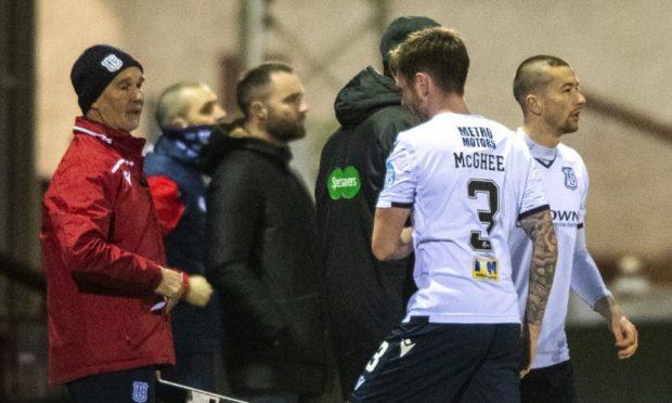 James McPake looks on as Dundee midfielder Jordan McGhee goes off injured against Arbroath.