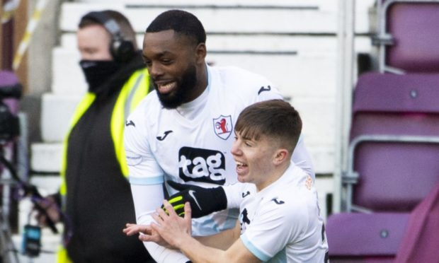 Raith Rovers duo Gozie Ugwu (L) and Kai Kennedy (R) celebrate.