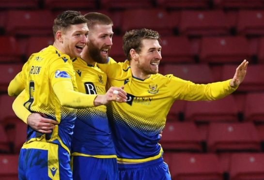 Liam Gordon celebrates with Shaun Rooney and David Wotherspoon.