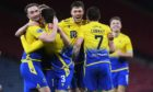 Saints celebrate their third goal against Hibs in the semi-final.