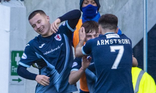 Kai Kennedy (centre) celebrates after he makes it 3-1.