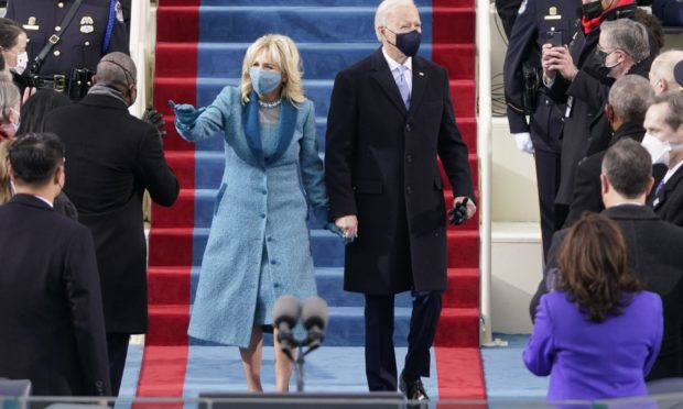 President-elect Joe Biden and his wife Jill, walk out for the 59th Presidential Inauguration at the U.S. Capitol in Washington.
