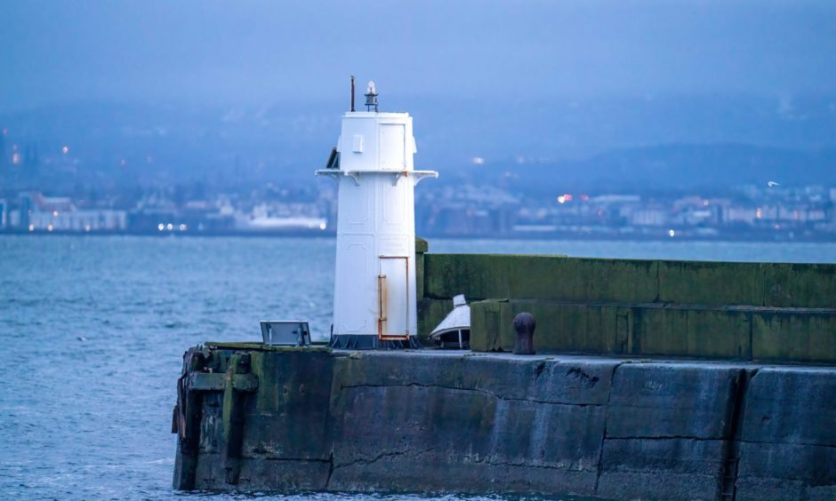 The lighthouse without its lantern after being struck by a Russian ship as it left Burntisland Harbour.
