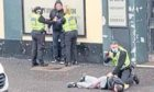 A man was knocked unconscious while being arrested in Clepington Road, Dundee.