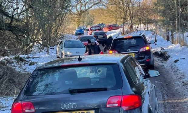 Police had to be called to clear the road at the Fife beauty spot after it was besieged with visitors despite the lockdown.