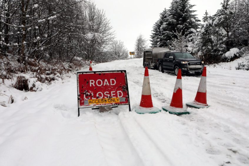 The Dundee to Glamis road was closed because of snow.