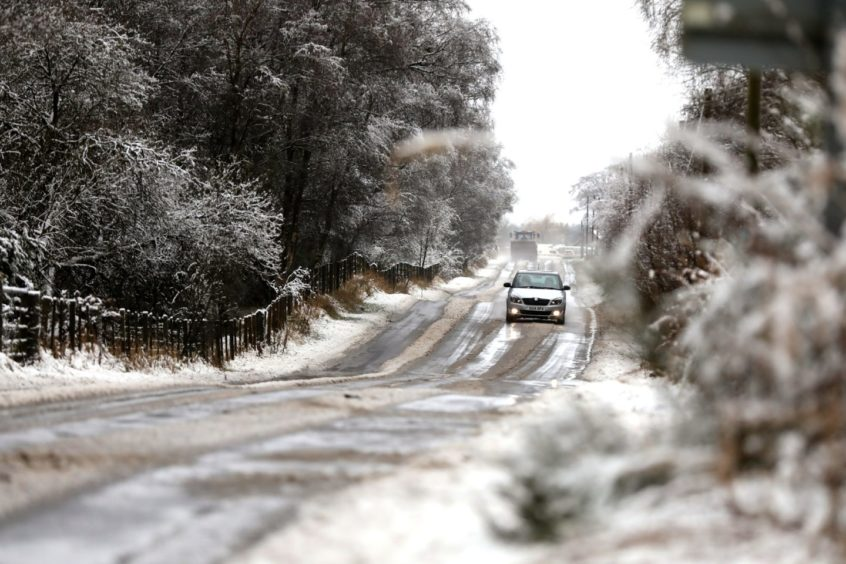 The Kirreimuir to Horney Cross road covered in snow.