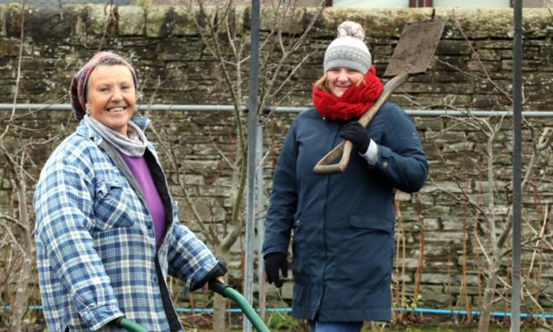Laura Tierney (left) and Laura-May Kennedy at the Food is Free community garden.