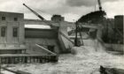 Water pours through the flood gates at Pitlochry Dam in August 1950, the year before it officially opened in 1951.
