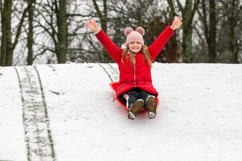 Following her morning school lessons at home, Willow Ason took the opportunity to enjoy the snow at Caird Park, Dundee.