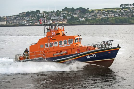 Tele News/Features. Ciaran Shanks story. Feature on emergency services in Dundee, pictures to be taken of Broughty Ferry Lifeboats team and specifically Murray Brown the coxswain. Picture shows; crew of Broughty Ferry RNLI Lifeboat on exercise on River Tay. Wednesday, 5th July, 2017.