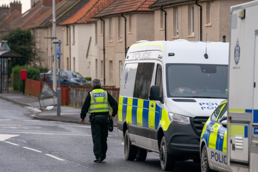Police activity in Kinglassie after Ean Coutts' body was identified.