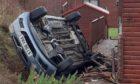 A car struck a power line when it crashed near Loch Leven.