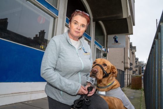 Joanne Robertson and her therapy dog Buddy at the charity's Cowdenbeath base which has been destroyed by flooding.