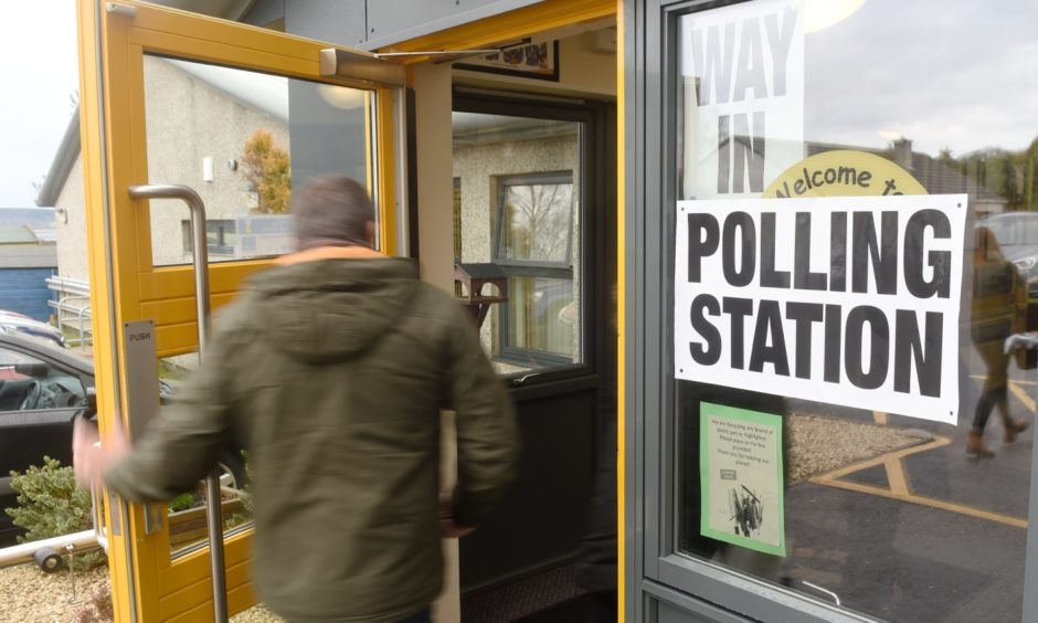 A voter enters a polling station.
