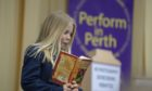 """Erin Fox from St Leonards reads from """"How to train your garden"""" by Cressida Cowell at Perform in Perth 2019."""