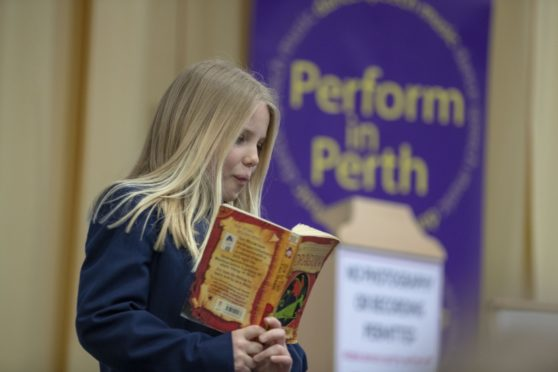 "Erin Fox from St Leonards reads from ""How to train your garden"" by Cressida Cowell at Perform in Perth 2019."