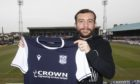 Paul McMullan will boost Dundee's Championship hopes after agreeing a loan switch.