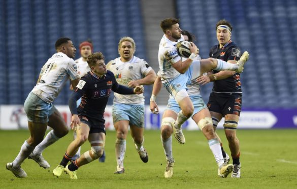 Ali Price collects the high ball under pressure at Murrayfield.