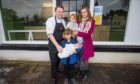 David Barnett and family -- his partner Marie Schade-Weskott holding Sophie (aged one) and sons William (aged six) holding Joseph (aged one month) at the Blasta Takeaway, 11 Perth Road, Stanley.