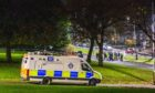 Police speaking to people in the Kirkton area of Dundee on Bonfire Night