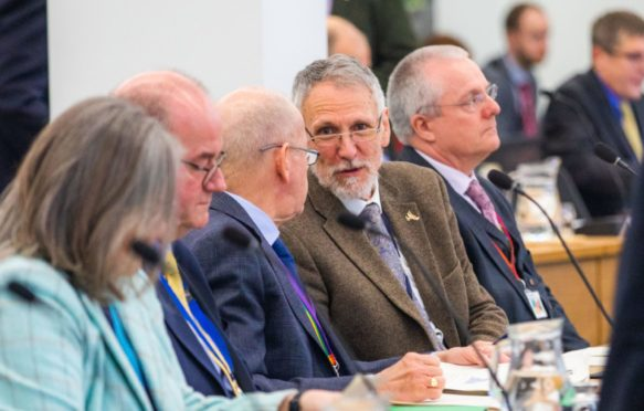 Lewis Simpson with council colleagues at a budget meeting in March 2020.