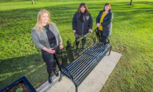 Sisters (left to right) Krystina Main, Karen Easton and Mhairi Cairns with the tribute bench - Jim Easton was their grandfather.