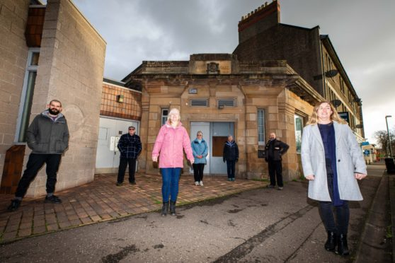 Rosyth EATS staff outside the former bank building that they plan to transform into a community hub.