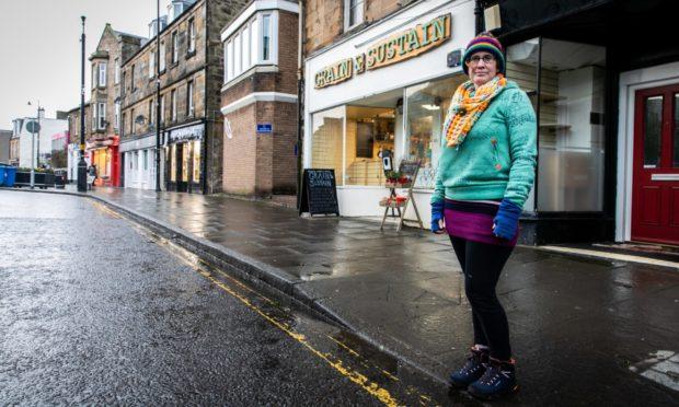 Louise Humpington outside her shop.
