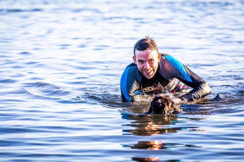 Jonny Boyne (39) with dog Buddy at SIlver Sands, Aberdour.