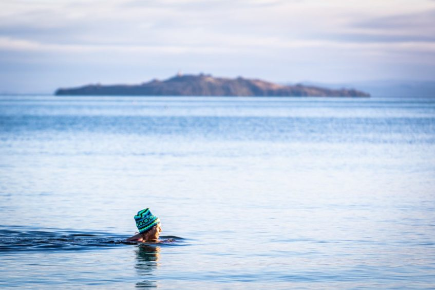 New Year Dooker Helen Davidson from Dunfermline enjoying her wild swimming in the Forth.