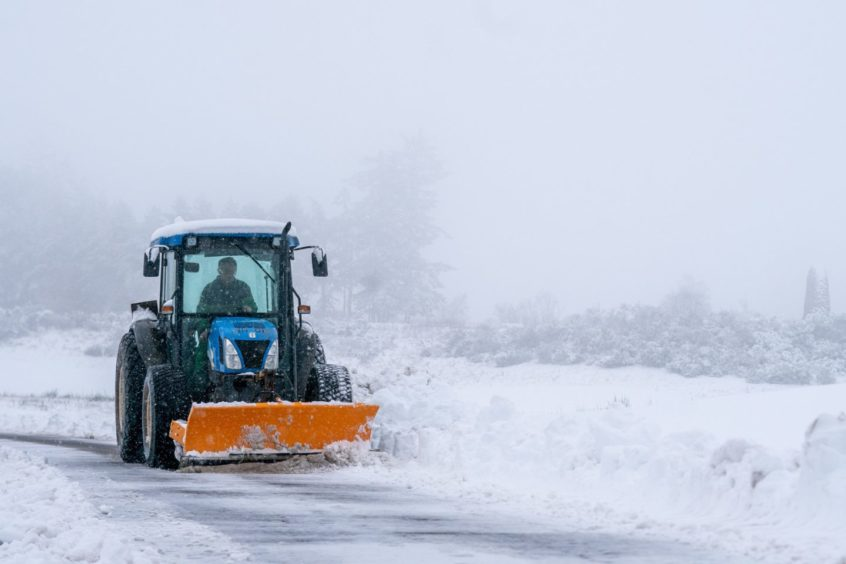 Tractors help keep the A823 clear near to Gleneagles.
