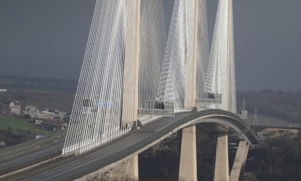 A patrol vehicle crosses The Queensferry Crossing after it was closed due to bad weather in February 2020.
