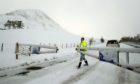 The snow gates are shut at the Spittal of Glenshee as snow brings fresh disruption to parts of the UK.