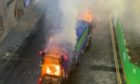 Smoke poured out of the bin lorry.