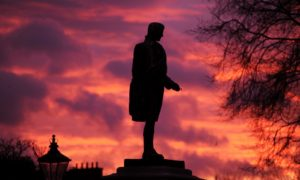 Sunrise over the Robert Burns statue at Union Terrace in Aberdeen.