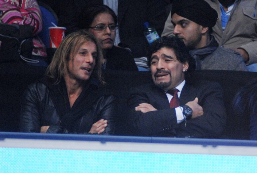 Claudio Caniggia and Diego Maradona pictured watching tennis in London in 2010.