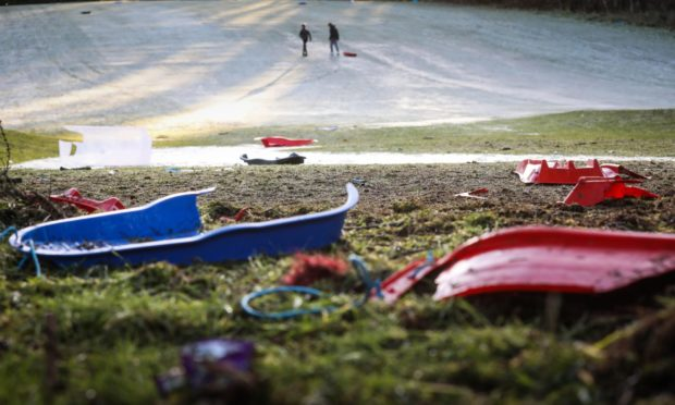 Discarded, broken sledges at Caird Park.