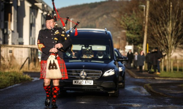 There was a procession following Cllr Henry Andersons funeral, led by Pipe Major Alistair Duthie.